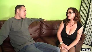 Voluptuous brunette is using her mammoth milk jugs to give a hard- grasp a guy