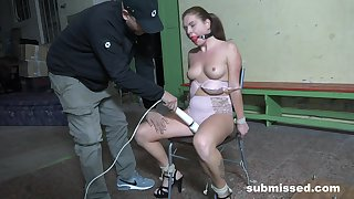 Slutty babe doomed up to a chair and penetrated with a fuck machine